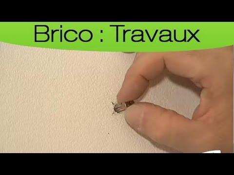 Fixer une cheville au mur : la bonne technique
