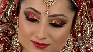bold traditional asian bridal red glitter makeup