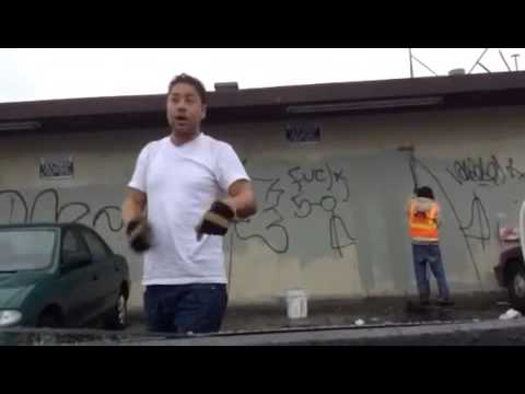 Ken Houston cleaning the Graffiti from streets of Oakland 1