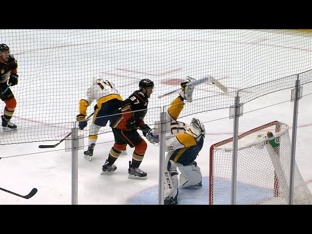 Pekka Rinne reaches behind his back for the save