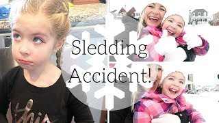 A SLEDDING ACCIDENT ON OUR FIRST SNOW DAY! | VLOGMAS DAY 10