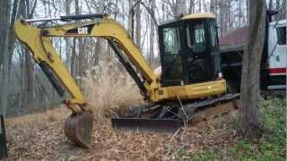 Cat 305 Excavator Tucked Away for the Winter