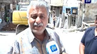 كوادر أمانة عمان تباشر العمل بإصلاح شارع سرور بوسط البلد - (9-5-2017)