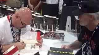 Greg Rucka signing copies of Patriot Acts at ComicCon