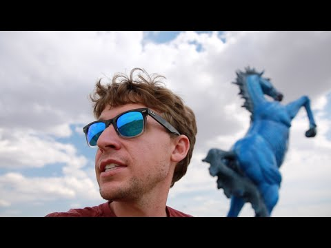 The Crazy Blue Horse is HUGE and SCARY (Denver Airport)