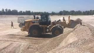 Cat 972M Wheel loader Loading Dump Truck (pt.1)