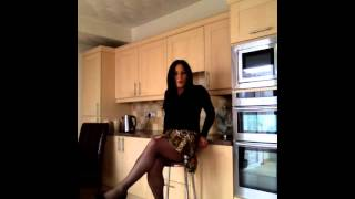 Crossdresser wearing sheer black tights.