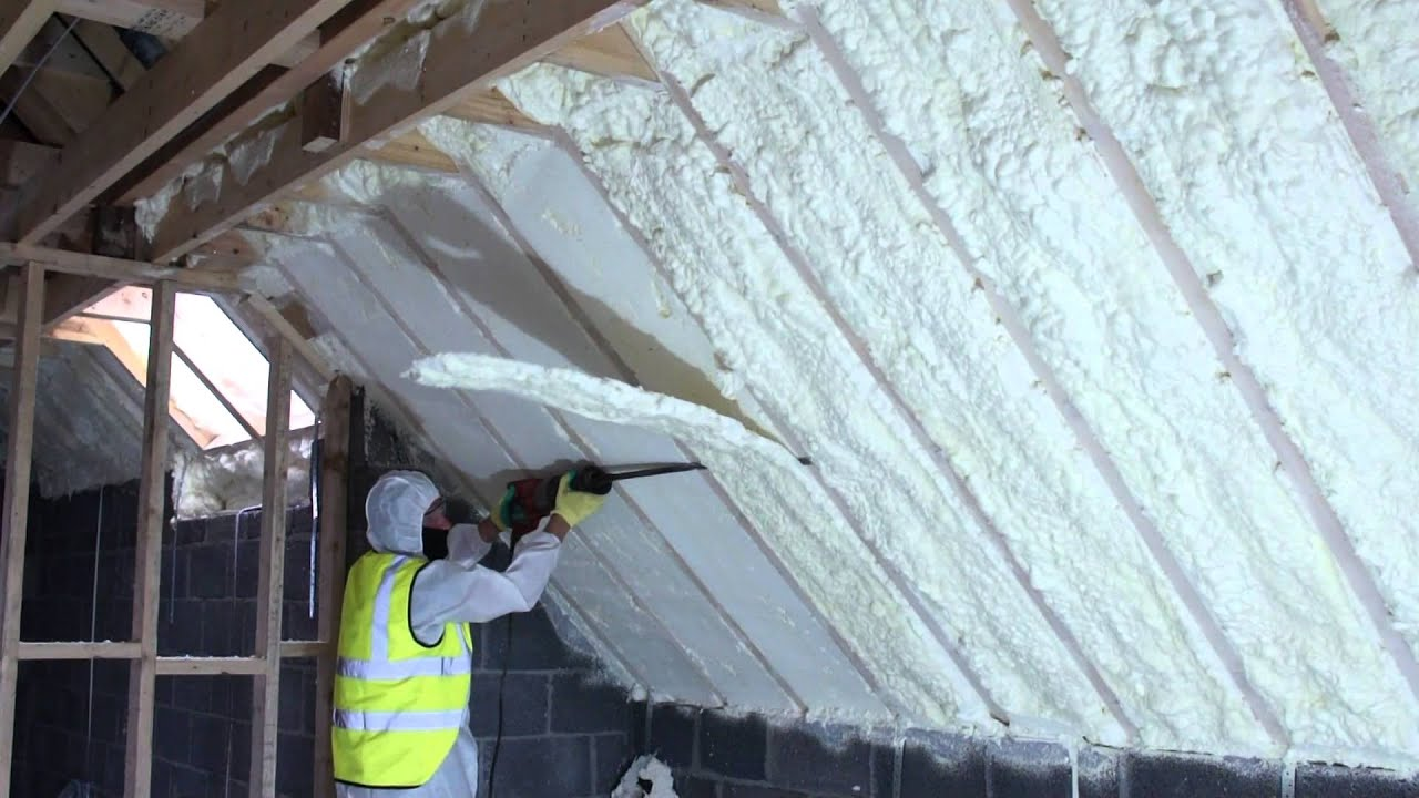 Spray Foam of attic and then Foam being cut evenly - YouTube