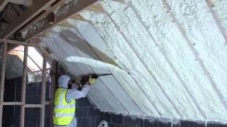 spray foam of attic using fusion sprayfoam insulation being cut flush www.fusioninsulation.com
