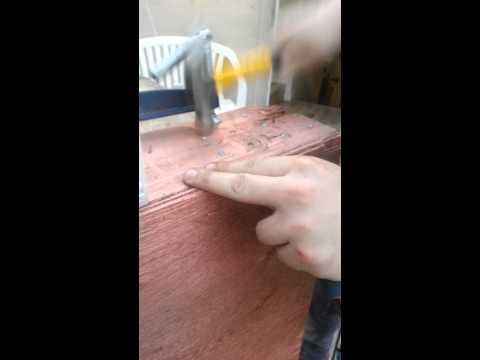 Idiot hammering in screws