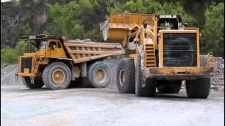 Huge Caterpillar 992 wheel loader loading a Caterpillar 777 dumper