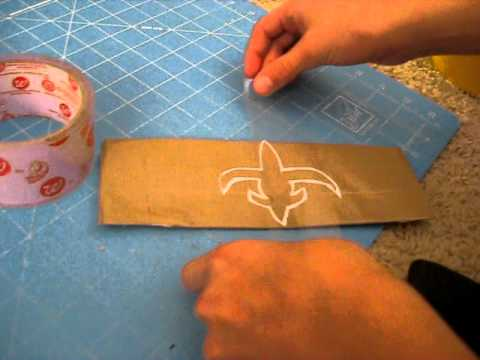Mini tutorial- how to use clear duct tape to preserve logos