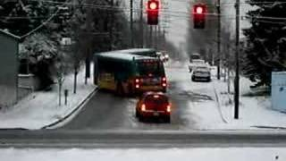 articulated bus in seattle slides on snow