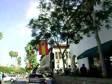 Skateboarding down State Street August Fiesta Santa Barbara