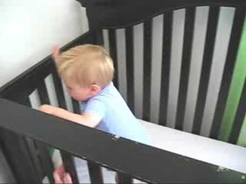 Jack Playing in his Crib with Mom