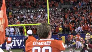 Band plays Tiger Rag while Andre Branch carries flag after ACC Championship