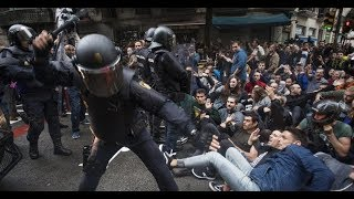 Violent police riots attacking peaceful people in the Catalan Referendum of the 1st of October 2017