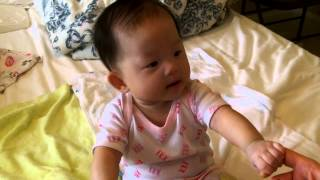 Baby Annelise trying to sit up 2