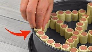 Режем сосиски на куски и складываем в форму для торта. Идеальные закуски!