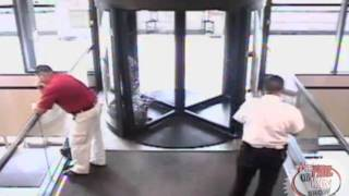 FAT GUY smashes revolving door!