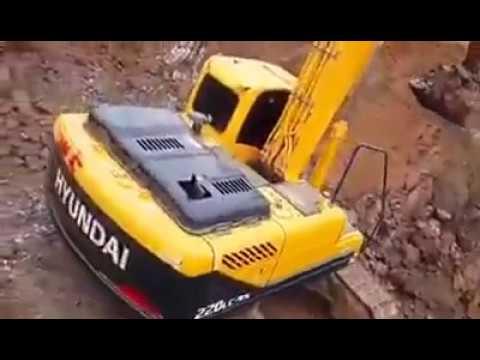 HYUNDAI 220Lc, Excavators Digging Soil For Road Construction