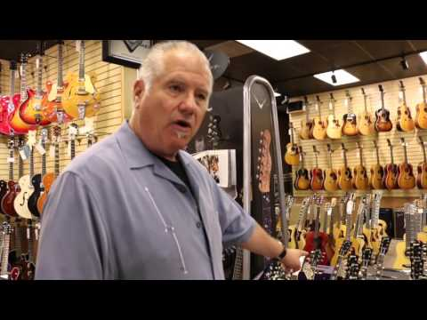 Norm giving a tour of his store Norman's Rare Guitars