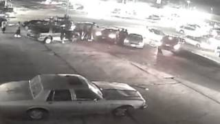 Tire Shop Surveillance Video Released in Shooting that Injured Eight 15-134656
