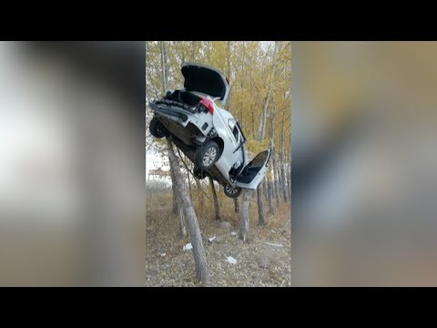 Crashed car trapped in trees in China