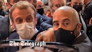 video: Emmanuel Macron pelted with egg by protester during restaurant fair visit