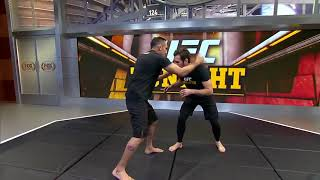 Tony Ferguson demonstrates a D'Arce choke with Kenny Florian   UFC TONIGHT