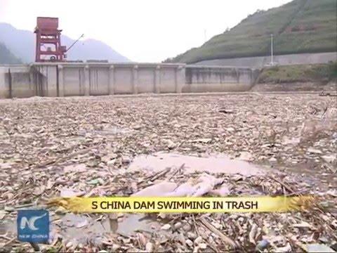 South China dam swimming in massive trash