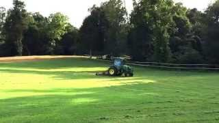John Deere 4066r mowing with Befco finish mower.