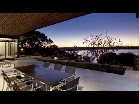 Resort style home overlooking Perth's Swan River this low-slung linear house opens to views