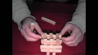 Four of Six wooden puzzle Brain Benders