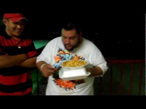 Fat guy eating like a pig