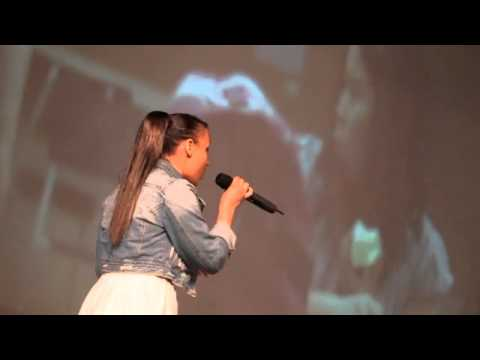 Singer Jasmine Richards performs on National Child and Youth