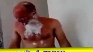 Try not laugh: Crazy Polish worker dips his head into a paint bucket