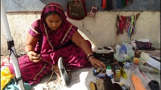 Roadside Lady Cobbler (shoe & sandal repairer) in Bardoli Town, Gujarat, India (Part 1).