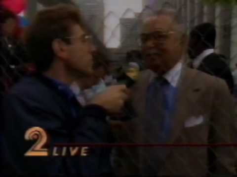 Coleman Young Interviewed Behind fence
