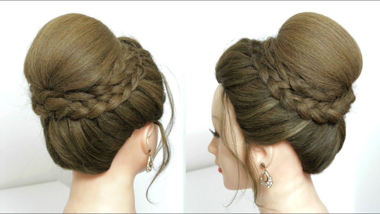 beautiful high bun hairstyle with dutch braids for wedding