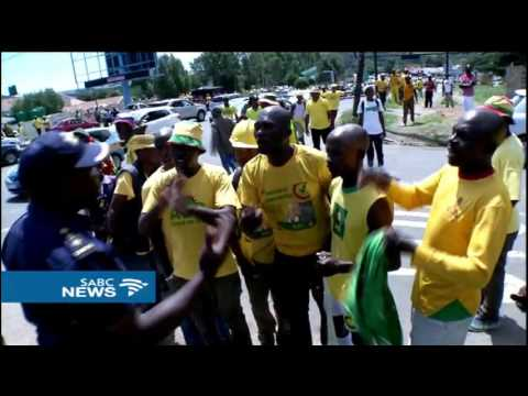 Opposition parties members march in Maseru to welcome exiled MP's