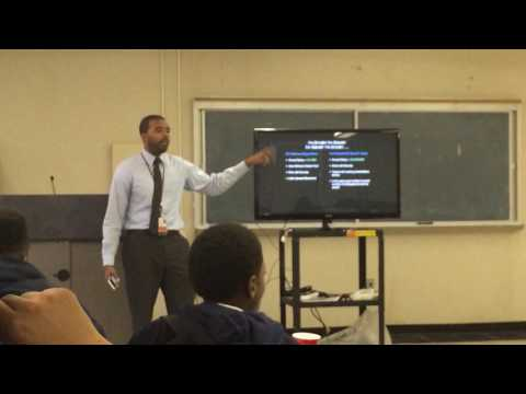 Osakwe Beale teaches students about Money $$ (2014)