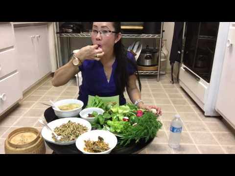 Eating homemade Lao foods.
