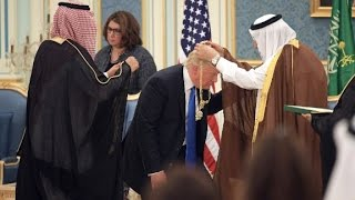 Saudi King Salman presented President Trump with a gold medal, the nation's highest honor., From YouTubeVideos