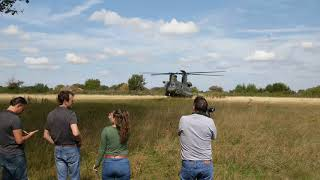 RAF Chinook landing and take off from field