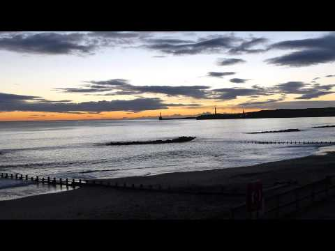 Ship sailing into Aberdeen Harbour just before sunrise HD