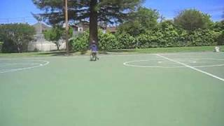 isaiah riding his bike on basketball court