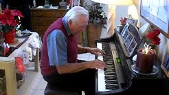 Jack Tourville plays  the piano at  the Dopps condo