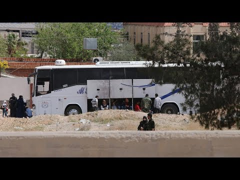 Rebels and their families flee Douma under Russia backed deal