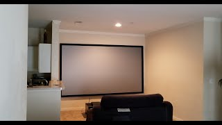 Home theater setup with a 135 inch silver ticket screen